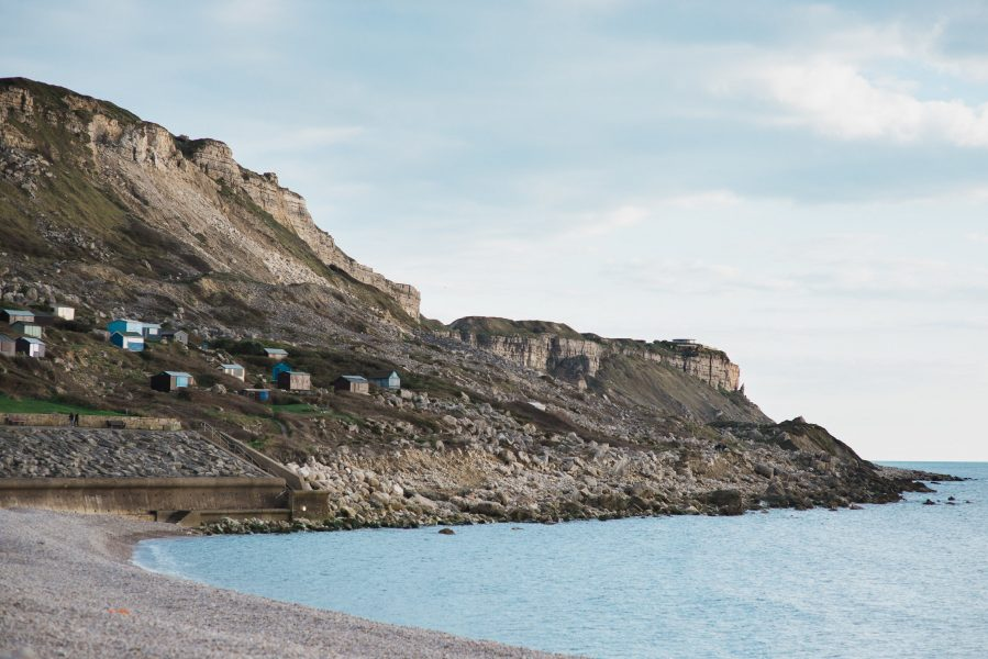 Landscape of Chesil beach and cliffs as the sun sets