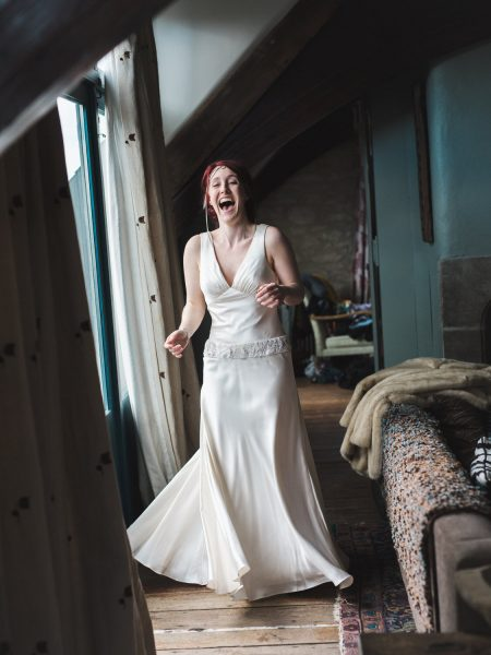 Bride with red hair twirling on her wedding dress at Stone House B and B Chesil beach