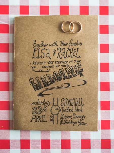 Rustic Natural wedding invitation on red check table cloth at Stone House B and B Chesil beach