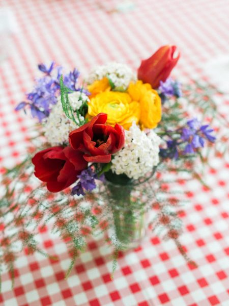 Rustic flowers on red white table cloth