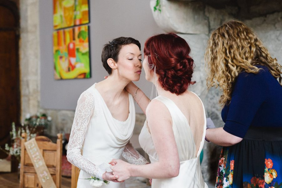 Two brides first kiss in Stone House converted chapel Chesil Beach