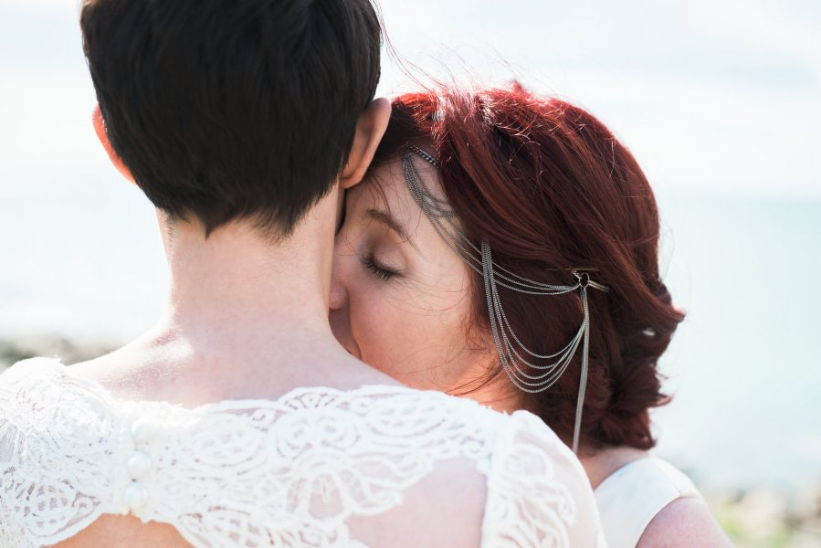 Two brides same sex wedding portrait on Chesil beach