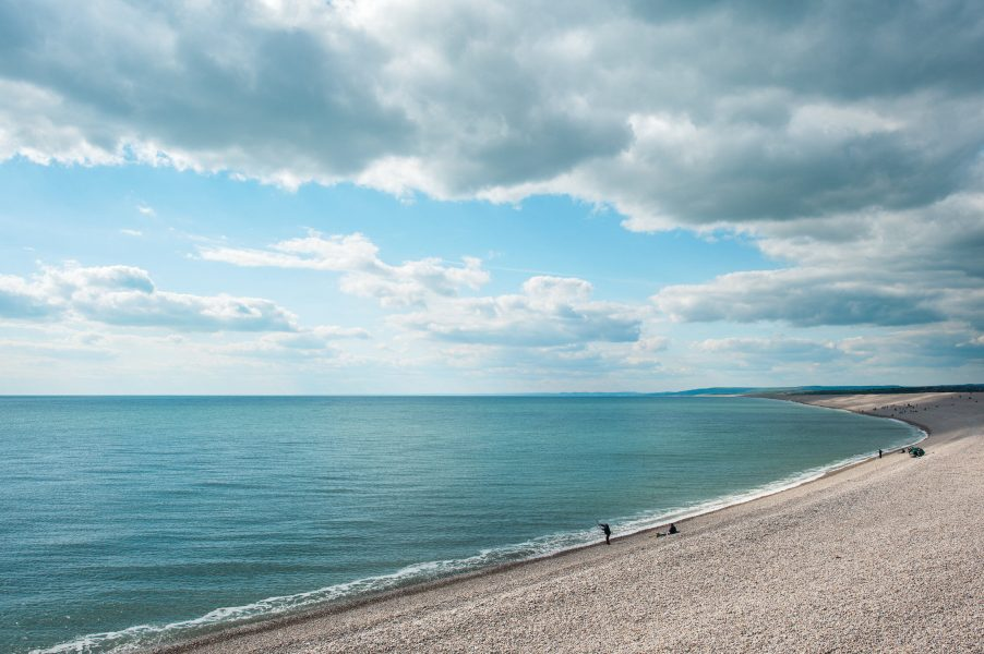 Landscape with moody clouds on Chesil Beach Dorset
