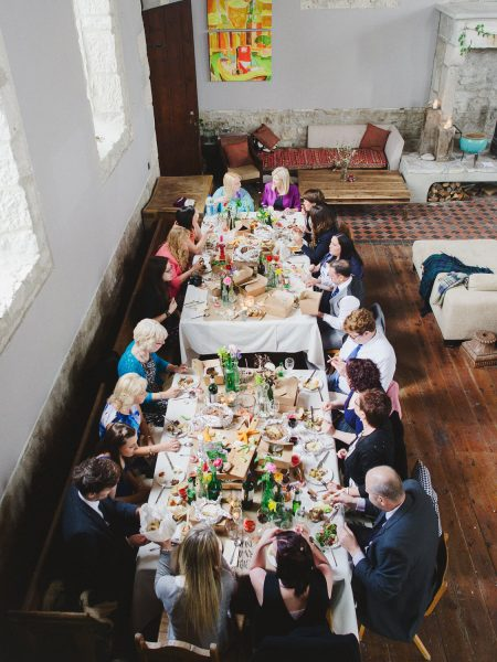 Guests eating rustic wedding picnic Stone House converted chapel Chesil Beach