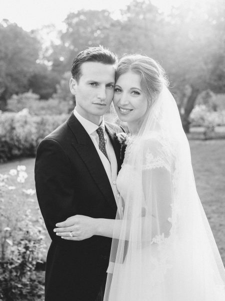 Black and white portrait of classic Bride and Groom facing camera at Fulham Palace London