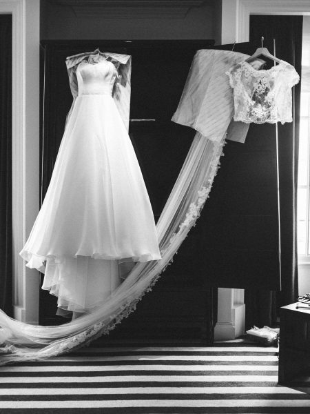 Black and white photo of wedding dress hang in in Bridal preparation room at Rosewood hotel London