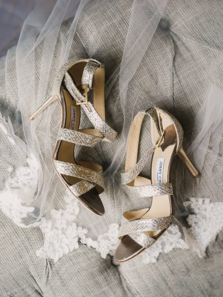 Gold metalic Jimmy Choo wedding shoes styled over veil at Rosewood hotel London
