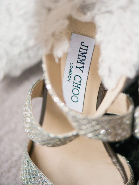 Gold metalic Jimmy Choo wedding shoes styled over veil