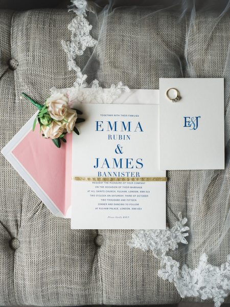 Wedding stationery styled with blush corsage flowers