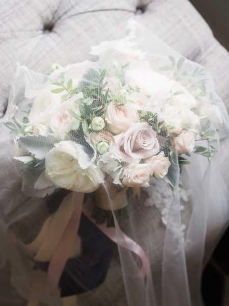 Fine art wedding bouquet in pastel pinks, blush and cream antique roses at Rosewood hotel London