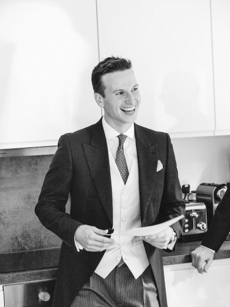 Black and white image of Groom practising speech during Groom Preparations