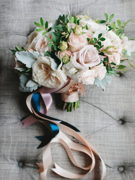 Fine art wedding bouquet in pastel pinks, blush and cream antique roses with blue and pink trailing ribbons at Rosewood hotel London