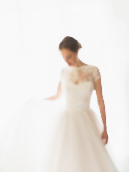 Dreamy blured Fine art wedding portrait of bride swishing dress at Rosewood hotel London
