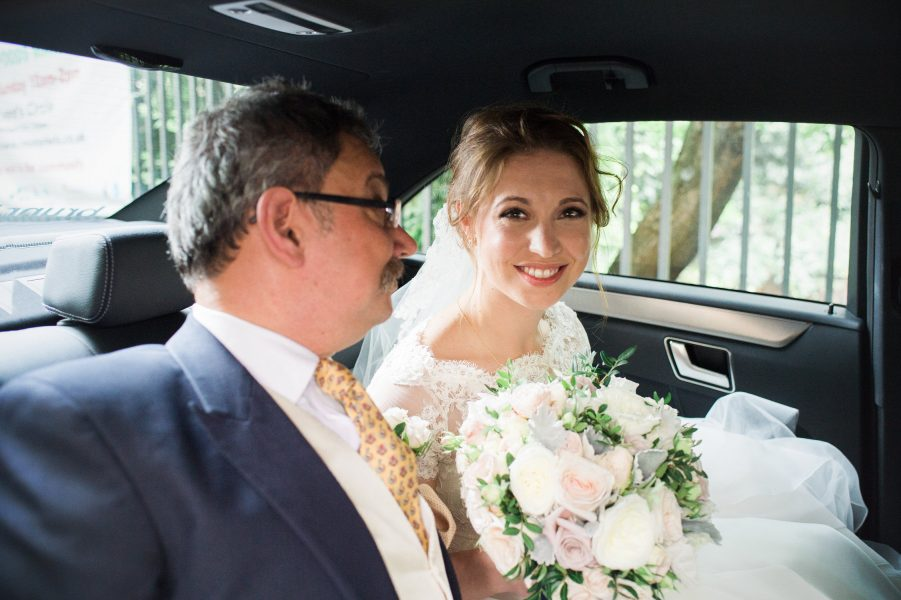 Bride arriving at Fulham Palace Abbey in car with father