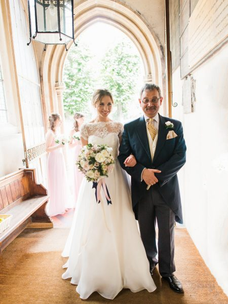 Bride and Father of the Bride arms linked ready to walk down aisle at Abbey at Fulham Palace London