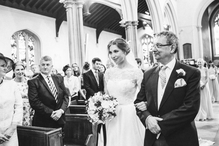 Bride walking down aisle with Father of the Bride at the Abbey Fulham Palace London