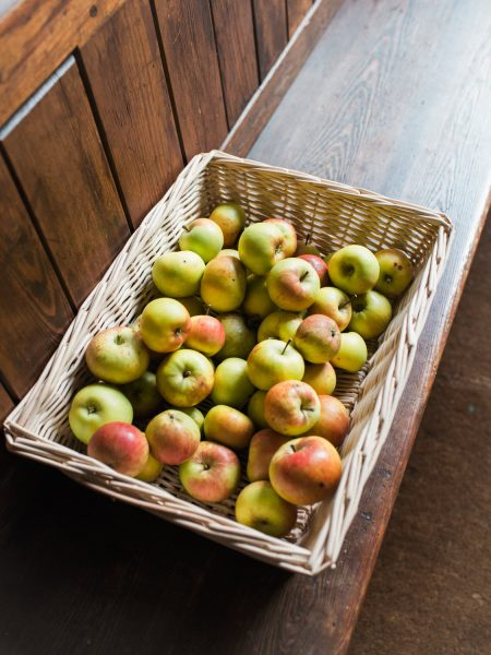 Box of pretty apples on pew at Abbey at Fulham Palace London