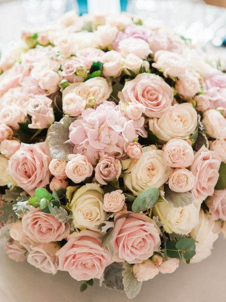Cloud of pink and blush table centrepiece flowers at Fulham Palace London