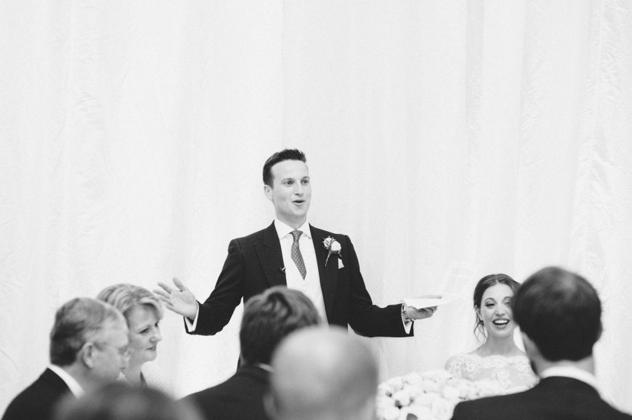 Animated Groom arms outstretched during his speech at Fulham Palace London