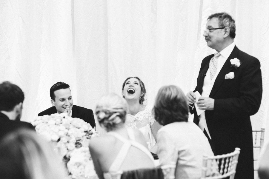 Animated Bride heartily laughing during her wedding at Fulham Palace London