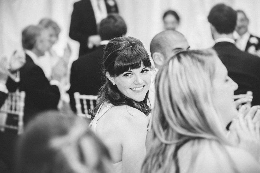 Bridesmaid smiling during wedding reception at Fulham Palace London