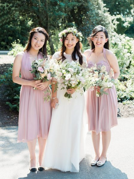 Fine Art full length Portrait of the Bride and two Bridesmaids all holding billowing loose bouquets of pastel flowers by Jay Archer just before the London wedding