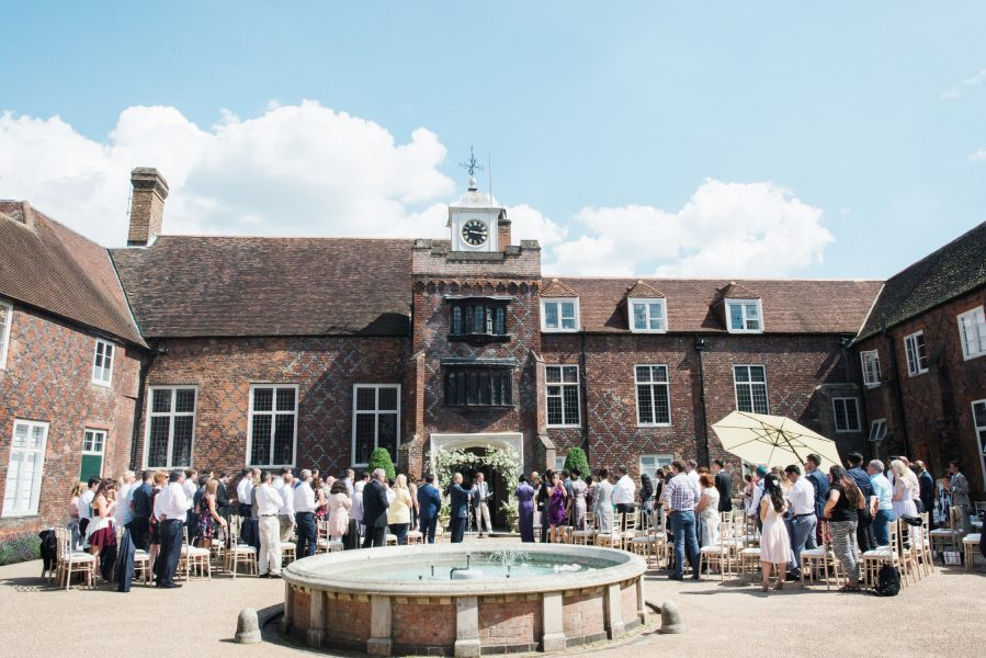 Fulham Palace London wedding pre ceremony build up in the courtyard with fountain