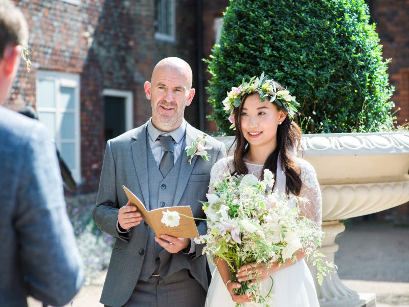 Bride and Groom taking vows during outdoor ceremony wedding ceremony Fulham Palace London wedding