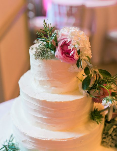 Cream buttercream wedding cake with pink roses on top Fulham Palace London