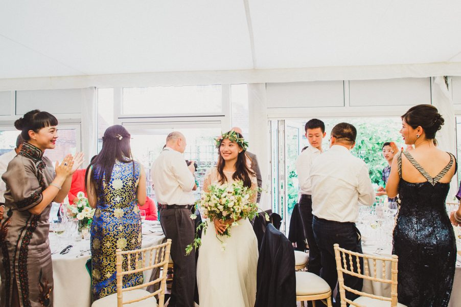 Bride and Groom enter the wedding breakfast marquee at Fulham Palace London