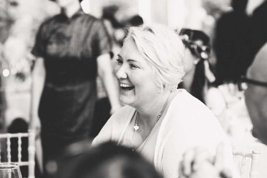 Guests laughing during wedding breakfast Fulham Palace London