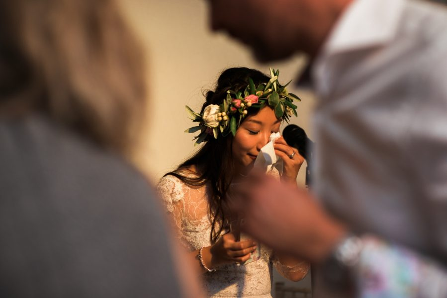 Bride in floral crown crying as she makes a speech at Fulham Palace London