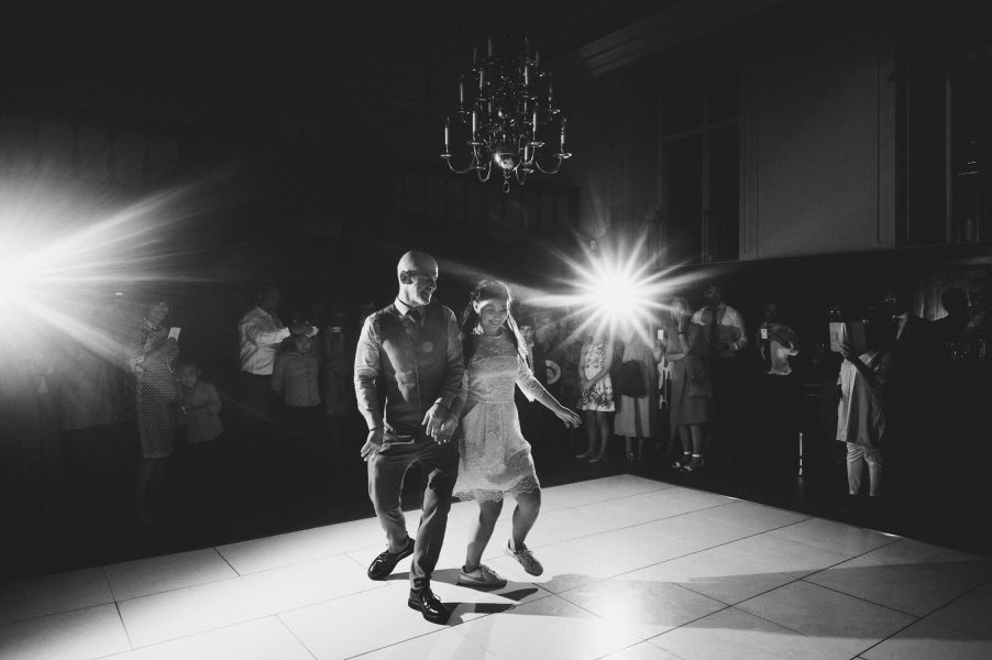 Black and White fun first dance image of Bride and Groom at Fulham Palace London