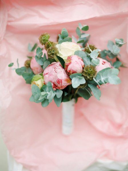 Peony and eucalyptus Bridal bouquet on pink tissue paper