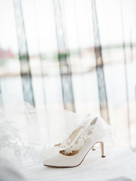 Wedding shoes styled with veil