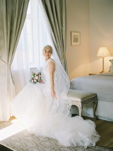 Fine art portrait of Bride in elegant bedroom Kokkedal Slot Copenhagen