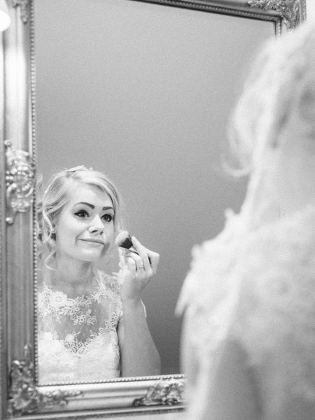 Fine art portrait of Bride applying make up in elegant bathroom at Kokkedal Slot Copenhagen