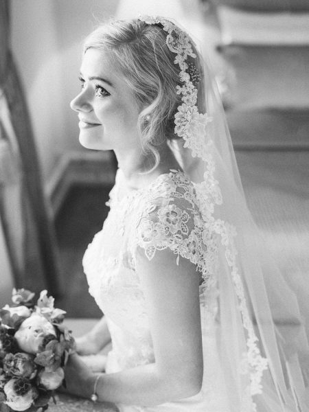Black and White Fine art portrait of Bride smiling holding bouquet Kokkedal Slot Copenhagen