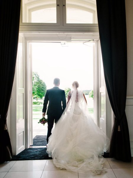 Back view of Bride and Groom exiting Fine art portrait of Bride facing camera in elegant bedroom Kokkedal Slot Copenhagen