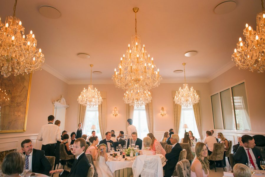 Wedding breakfast overall view of guests enjoying themselves at Kokkedal Slot Copenhagen