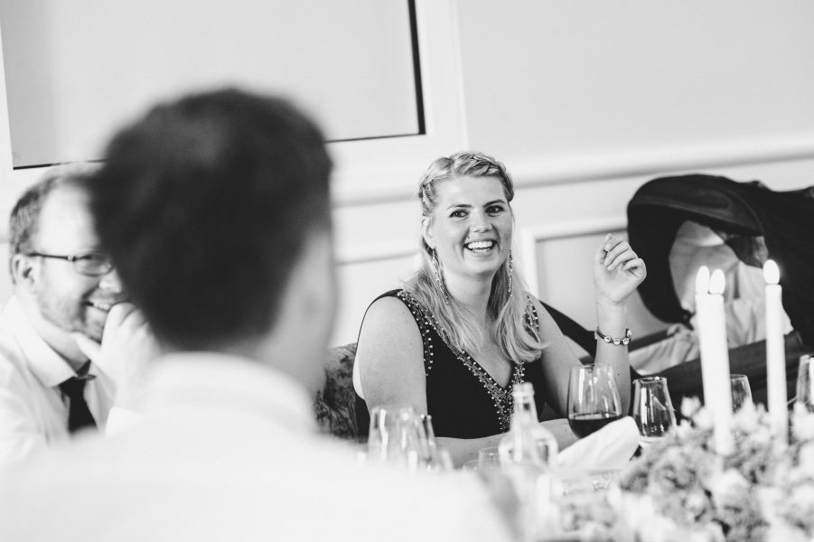 Guests laughing during wedding reception at Kokkedal Slot Copenhagen
