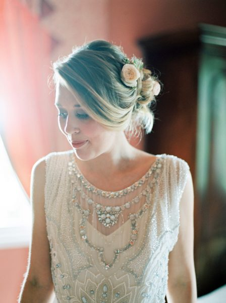 Fine Art Portrait of Bride with blush roses in her hair in fresh make up and sequinned Jenny Packham Dress on her wedding day in Wiltshire