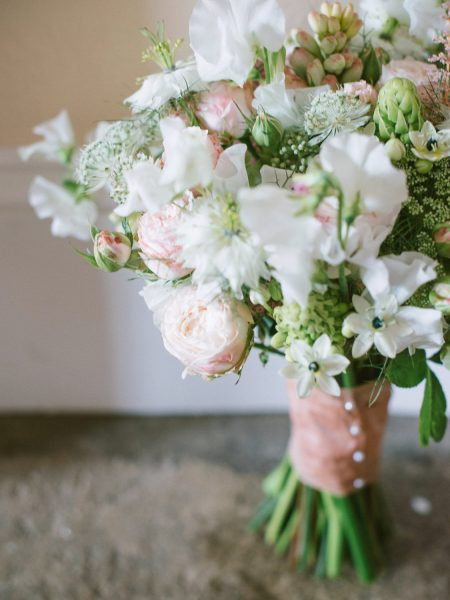 Wedding Flowers Bouquet of sweet peas and roses in blush and cream Larmer Tree Gardens Wiltshire