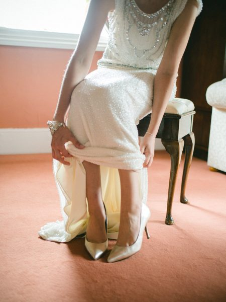Bride's dress from the shoulders down and shoes on a wedding day in Wiltshire