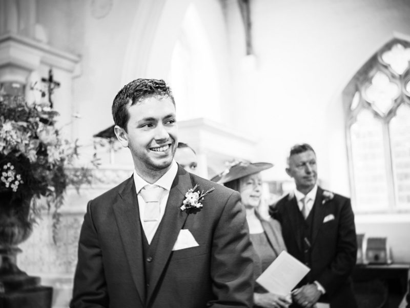 Groom emotionally watching Bride walk down the aisle Wiltshire