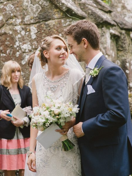 Bride and Groom gaze into each other's outside the church after the ceremony Wiltshire wedding