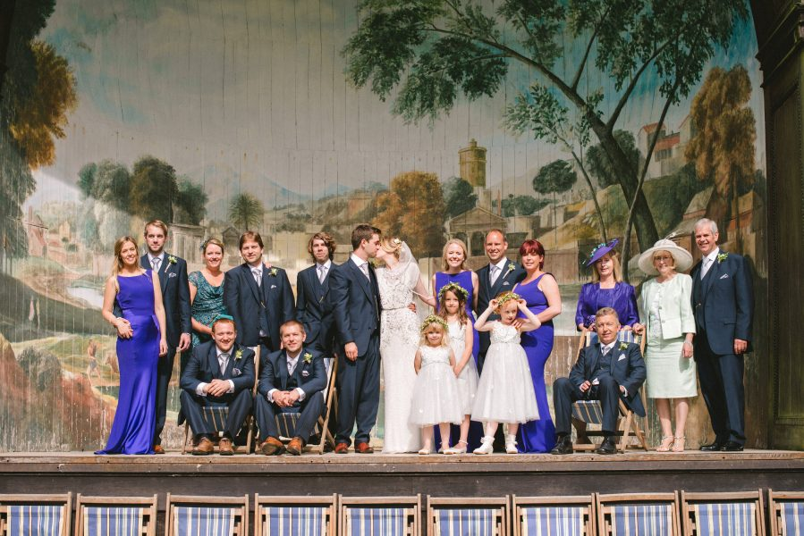 Group Portrait of Bridal Party on stage Singing Theatre Larmer tree Gardens Wiltshire
