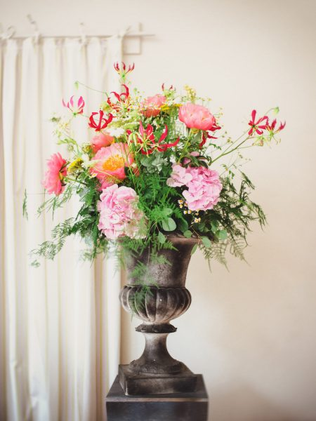 Urn full or peony elegant rustic colourful wedding flowers