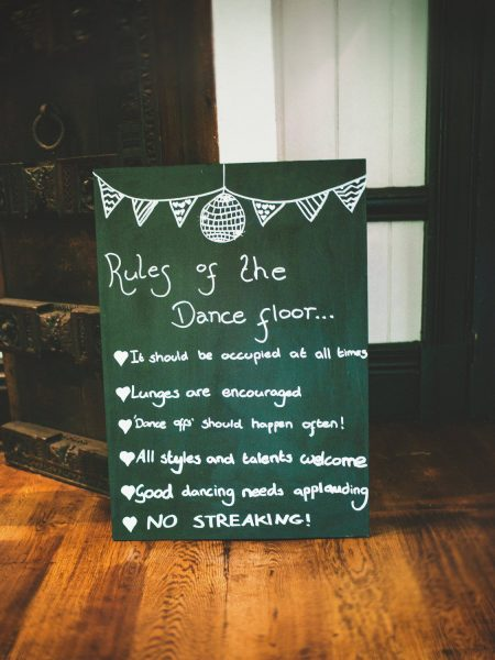 Wedding sign chalk blackboard encouraging dancing Larmer Tree Gardens Wiltshire