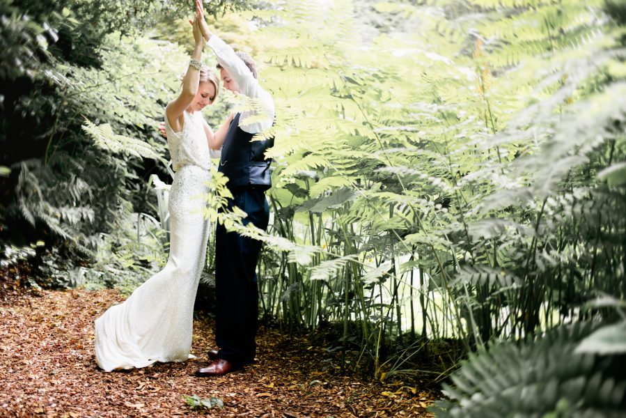 Bride and Groom dance in a magical secret garden within the grounds of Larmer Tree Gardens Wiltshire